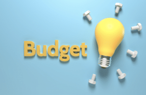the word budget with a lightbulb